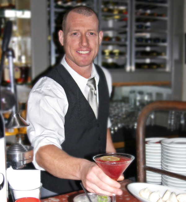 Bartender serving cocktail