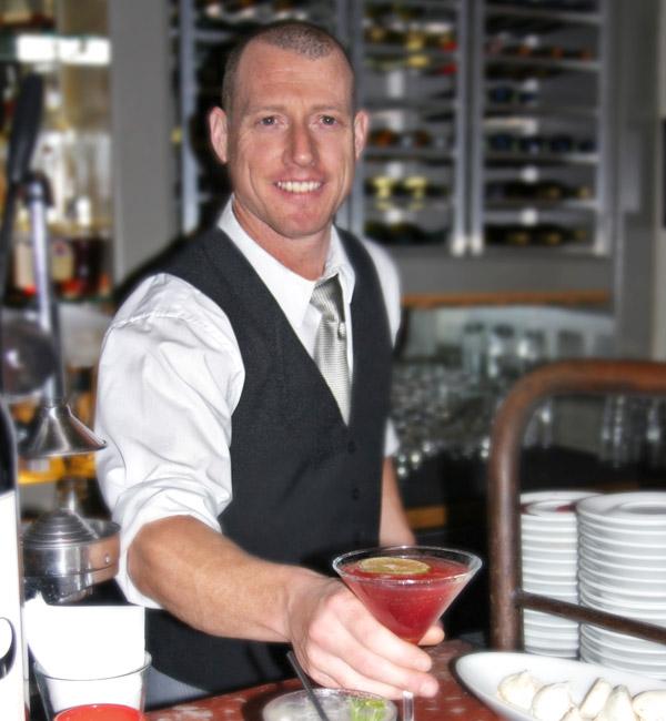 Bartender serving cocktail